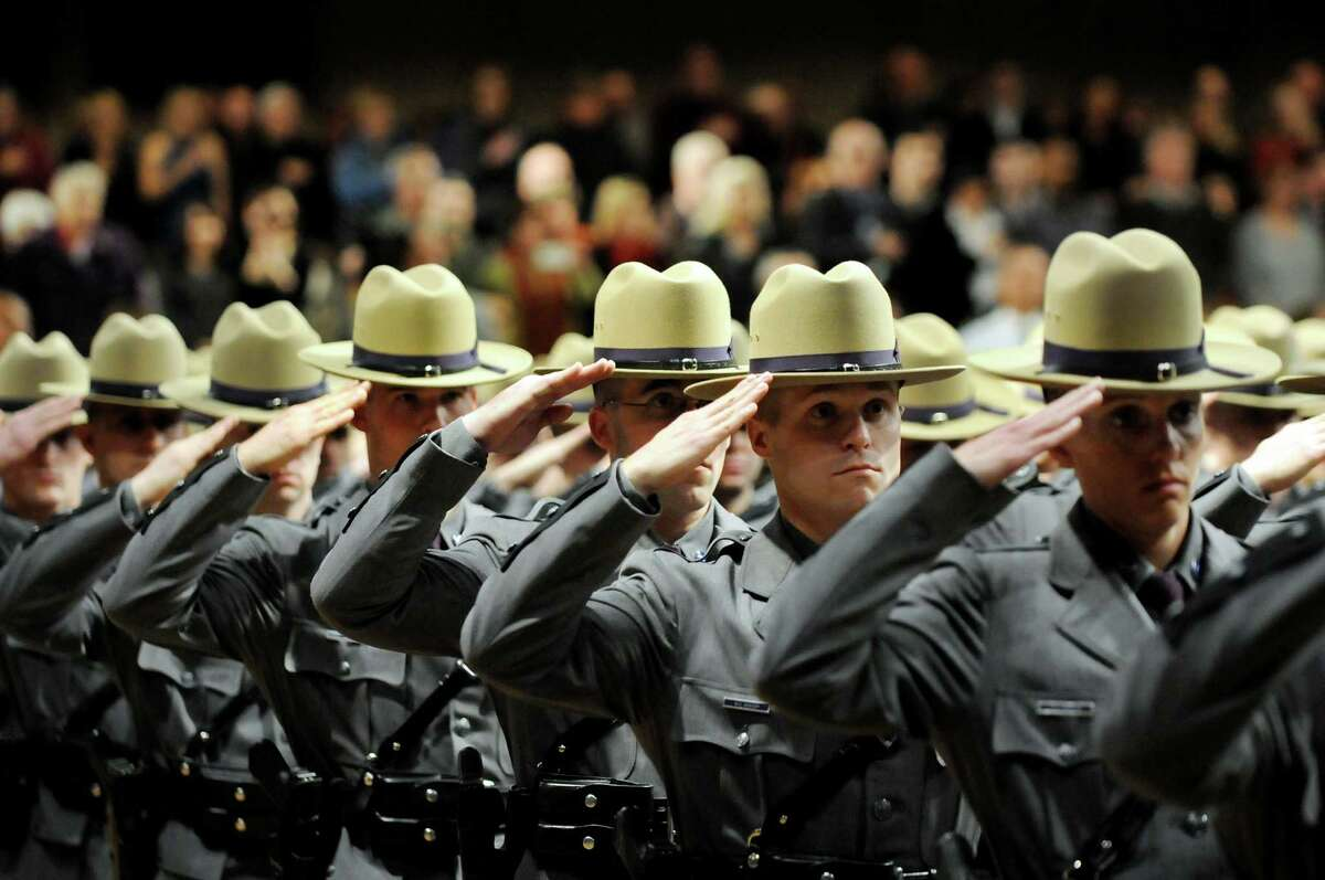 Graduates salute during the playing of the National Anthem at the New York State Police Academy graduation on Tuesday, Dec. 10, 2013, at the Empire State Plaza Convention Center in Albany, N.Y. Nearly 200 new troopers completed the 200th session of the Basic School of the New York State Police Academy. (Cindy Schultz / Times Union)