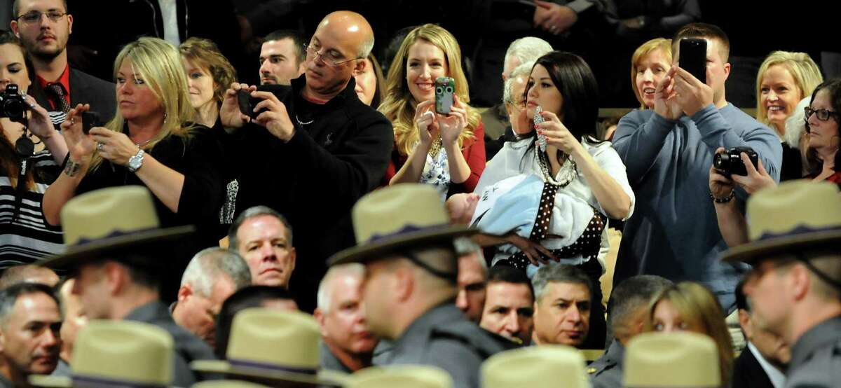 Family and friends take pictures as graduates file in for the New York State Police Academy graduation on Tuesday, Dec. 10, 2013, at the Empire State Plaza Convention Center in Albany, N.Y. Nearly 200 new troopers completed the 200th session of the Basic School of the New York State Police Academy. (Cindy Schultz / Times Union)