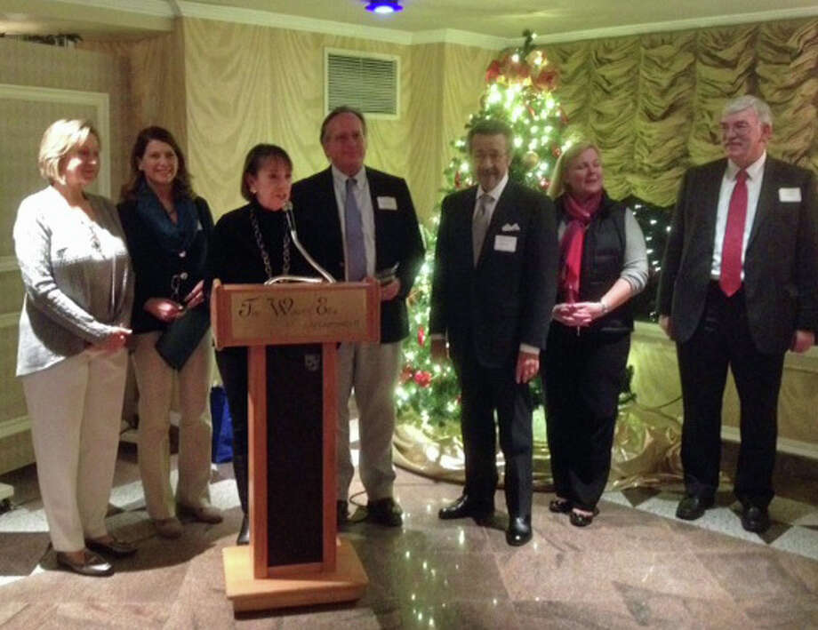 At the annual meeting of the Darien Chamber of Commerce where Volunteer of the Year and Business of the Year were presented were, from left, Carol Wilder-Tamme, chamber president; state Rep. Terrie Wood, R-Darien; First Selectman Jayme Stevenson; chamber Chairman Al Tibbetts of Tibbetts, Keating & Butler LLC; Charles Napolitano, Callari Auto Group/BMW of Darien; Laurie Griffith, Darien Bank & Trust and chamber board member; and Matt Cosgrove, Callari Auto Group/BMW of Darien. Photo: Contributed Photo, Contributed / Darien News Contributed