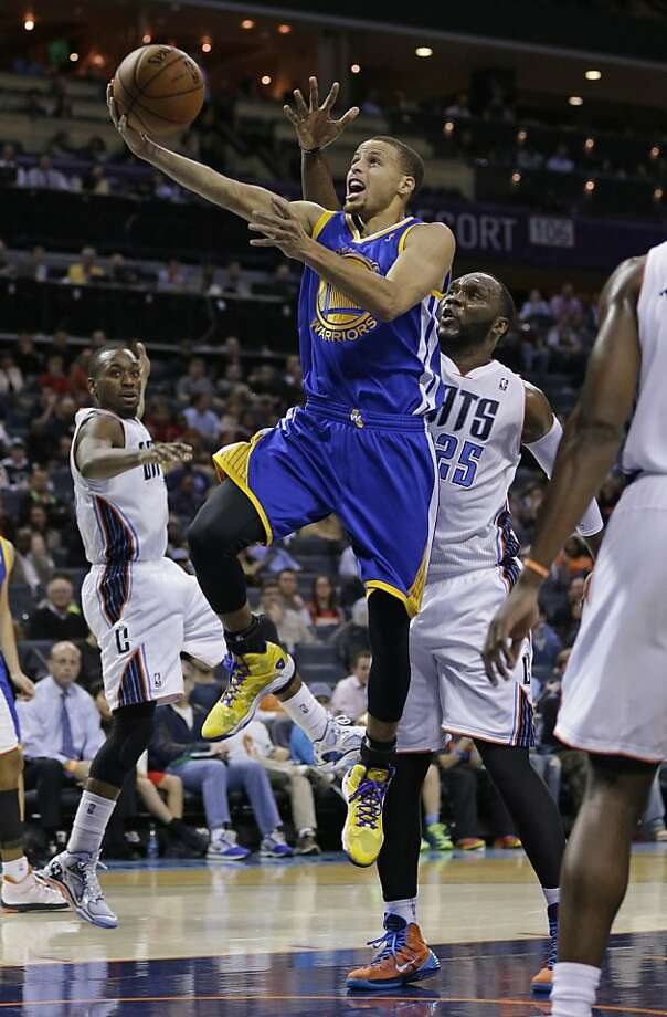 Golden State Warriors' Stephen Curry (30) drives past Charlotte Bobcats' Al Jefferson (25) during the second half of an NBA basketball game in Charlotte, N.C., Monday, Dec. 9, 2013. The Bobcats won 115-111. (AP Photo/Chuck Burton) Photo: Chuck Burton, Associated Press
