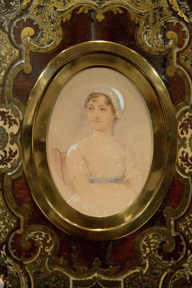 "FILE - A file photo dated Friday, Dec. 6, 2013 shows a portrait of novelist Jane Austen by James Andrews, in Sotheby's auction house, London. The watercolor portrait of ""Pride and Prejudice"" author Jane Austen has sold for 164,500 pounds ($270,230) at a London auction. The watercolor by James Andrews was commissioned by Austen's nephew in 1869. It was put on the block by the Austen family and, according to Sotheby's, rarely has been seen in public. (AP Photo/PA, Laura Lean, File) UNITED KINGDOM OUT NO SALES NO ARCHIVE ORG XMIT: LON894 Photo: Laura Lean / PA"