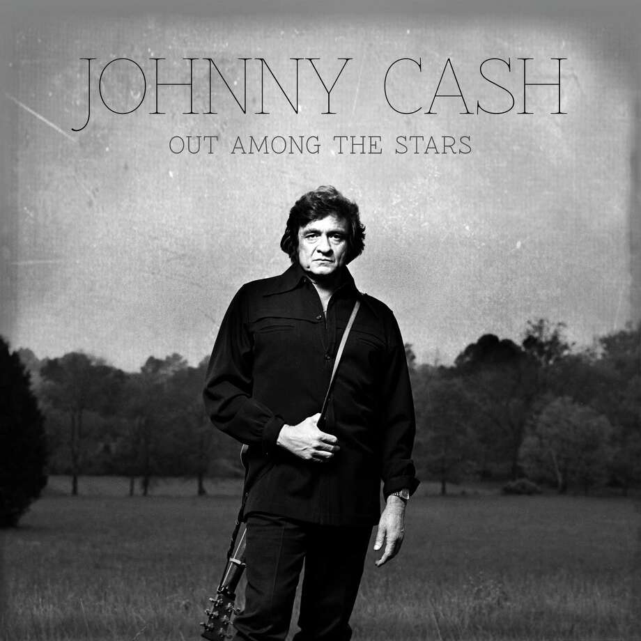 "This photo provided by Columbia/Legacy shows the Johnny Cash album cover for ""Out Among the Stars,"" releasing March 25, 2014. The new album is comprised of 12 studio recordings by Cash that were recently discovered. (AP Photo/Columbia/Legacy) ORG XMIT: CAET731 / Columbia/Legacy"