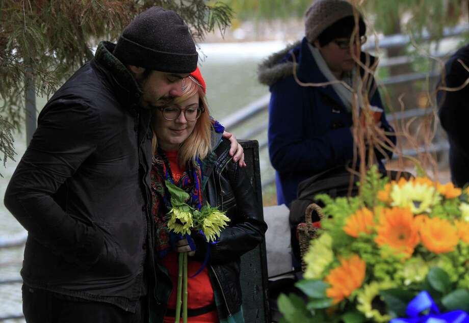 Justin Roubique and Kellie Prinzel comfort each other during the Memorial Service for Chelsea Norman, 24, a cyclist who was hit by a motorist Dec. 1st near the corner of Waugh and West Gray, on the edge of the Buffalo Bayou on Monday, Dec. 9, 2013, in Houston. Photo: Mayra Beltran, Houston Chronicle / © 2013 Houston Chronicle
