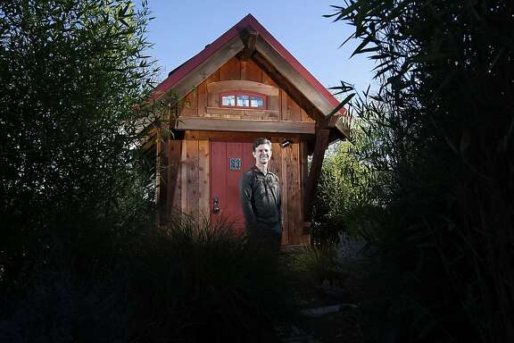 """Jay Shafer, owner of Jay Shafer's Tiny House Co., poses for a portrait in front of his 119 square foot """"Gifford"""" model house in Graton, CA Wednesday, December 4, 2013."""
