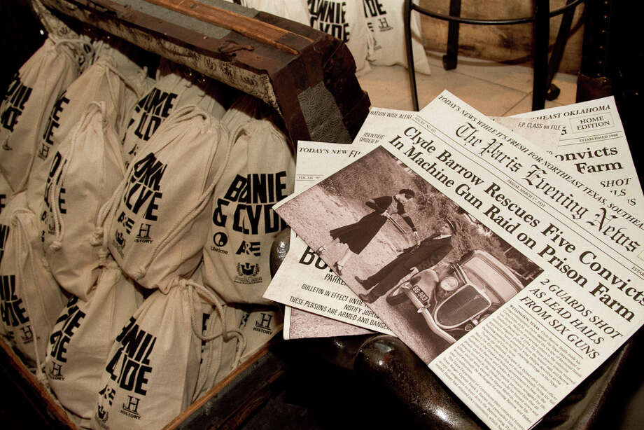 Bonnie & Clyde newspapers and giveaway liquor decanters at the Goorin Bros. party. Photo: Courtesy, Melissa De Mata