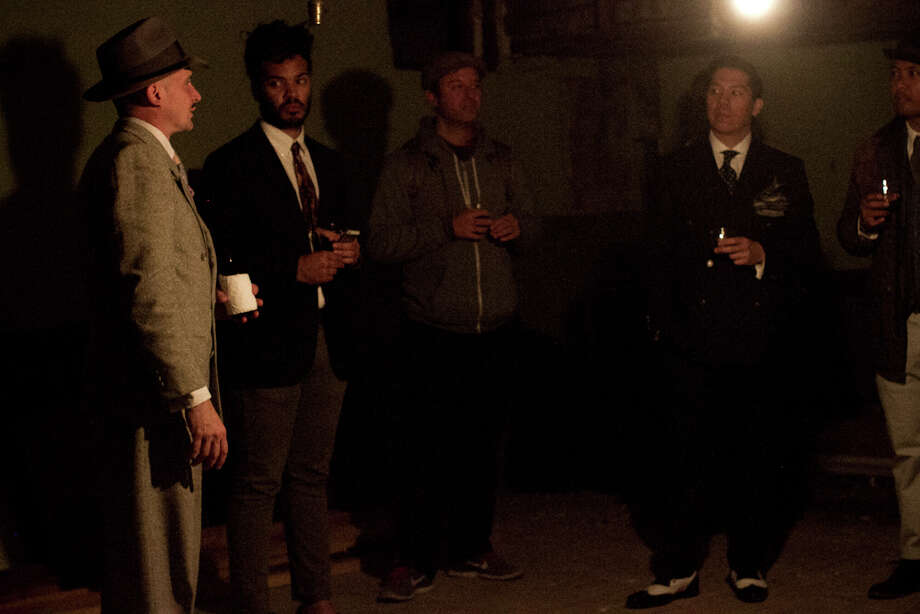 Johnny L. Stokes, left, takes guests on a tour of the underground speakeasy. Photo: Courtesy, Melissa De Mata