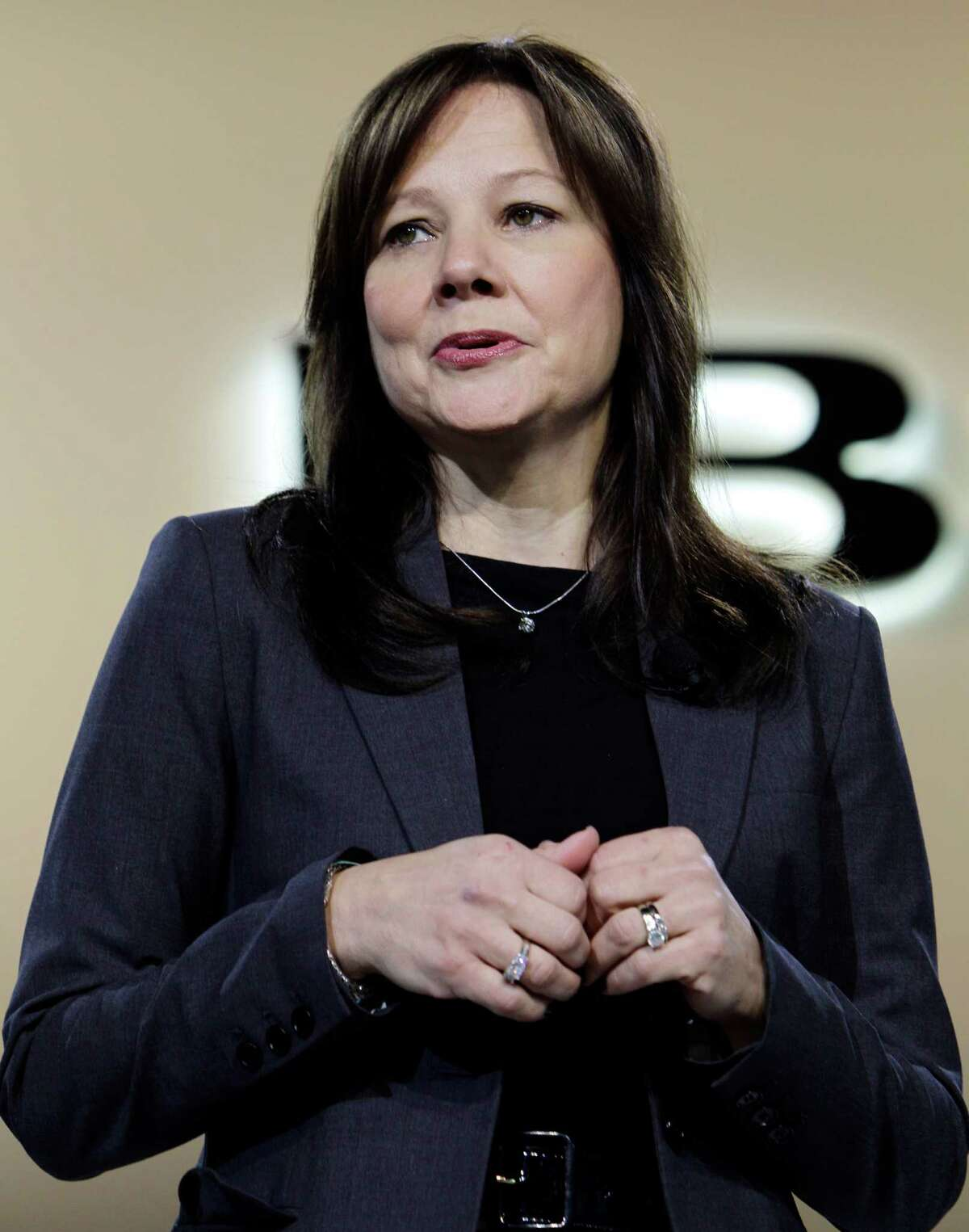 FILE - In this Jan. 10, 2012 file photo, Mary Barra, General Motors Senior Vice President, Global Product Development, speaks at the debut of the 2013 Buick Encore at the North American International Auto Show in Detroit. A person briefed on the matter on Tuesday, Dec. 10, 2013 said General Motors' board has named Barra as the company's next CEO. (AP Photo/Paul Sancya, File) ORG XMIT: NY109