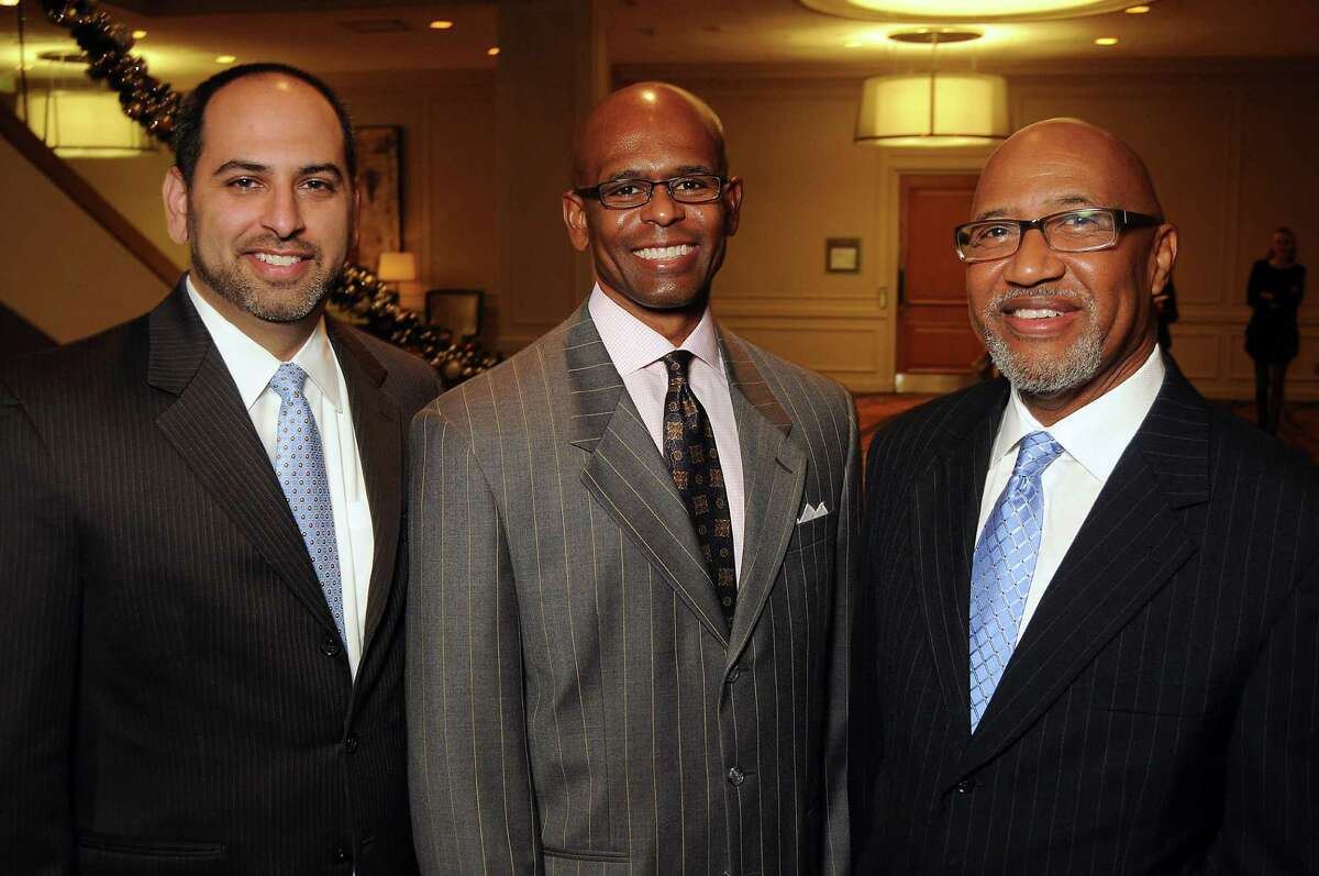 From left: Karim Kafray, Terrence Gee and Quinton Harp at the Angels of Hope Luncheon at the Westin Galleria Hotel Tuesday Dec. 03, 2013. (Dave Rossman photo)