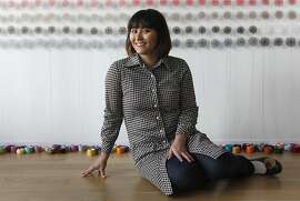 Artist Lisa Solomon in front of her 1000 doily installation in San Francisco, Calif., on Tuesday, December 10, 2013.