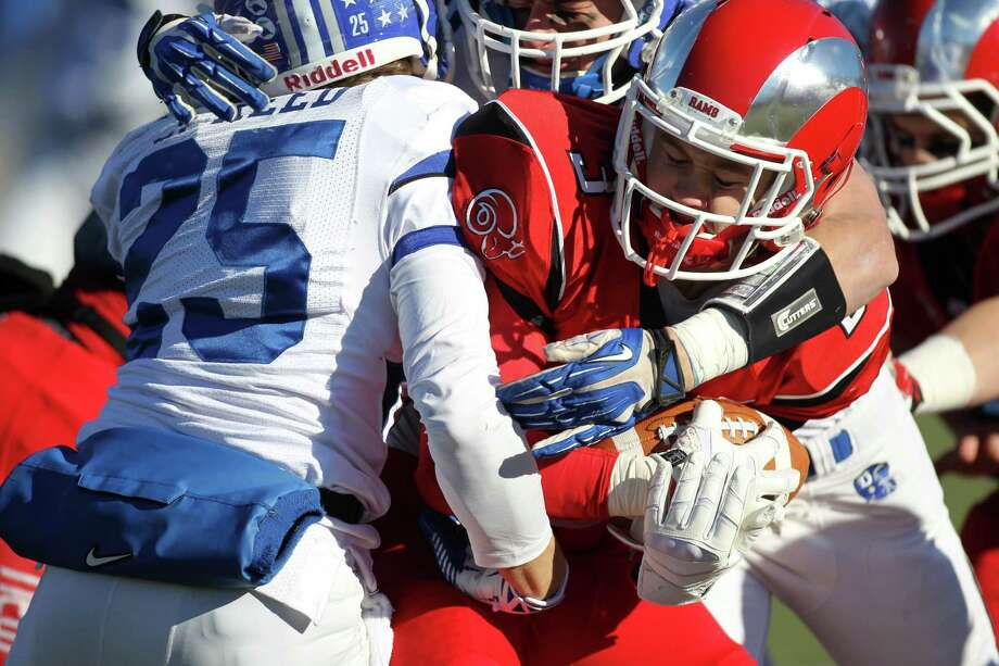 Darien High School vs New Canaan HS in the annual Thanksgiving Day Turkey Bowl football game in New Canaan, Conn. on Thanksgiving Day, Thursday, Nov. 28, 2013. Darien came out on top, 28-24. Photo: J. Gregory Raymond / Stamford Advocate Freelance;  © J. Gregory Raymond
