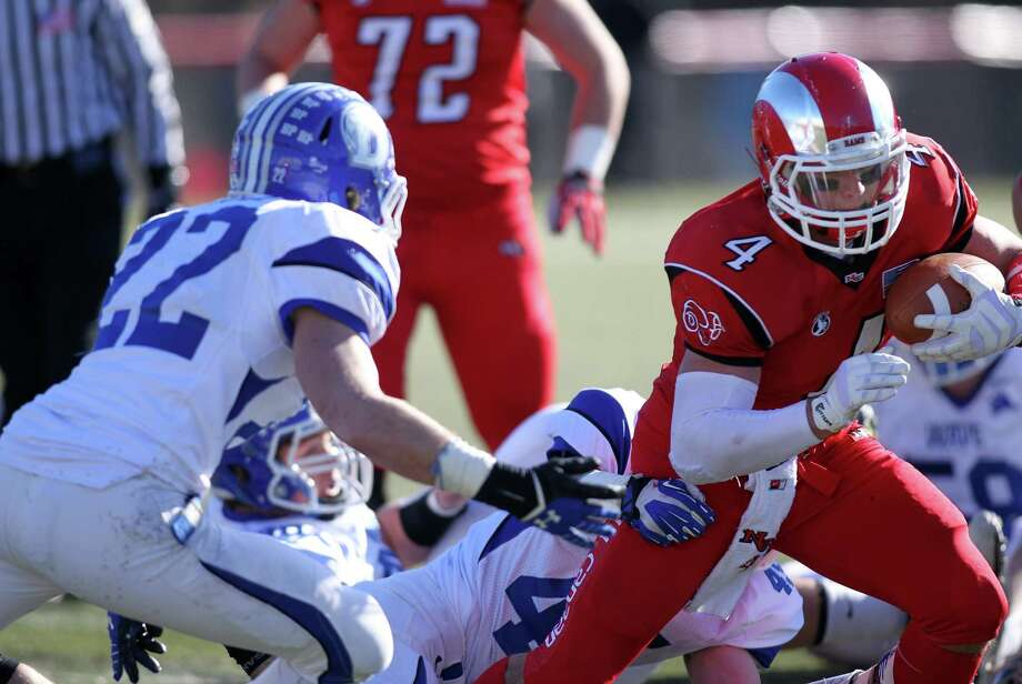 NC #4 Frank Cognetta - Darien High School vs New Canaan HS in the annual Thanksgiving Day Turkey Bowl football game in New Canaan, Conn. on Thanksgiving Day, Thursday, Nov. 28, 2013. Darien came out on top, 28-24. Photo: J. Gregory Raymond / Stamford Advocate Freelance;  © J. Gregory Raymond