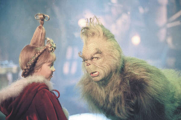 (KN2) KRT KIDNEWS STORY SLUGGED: GRINCH KRT PHOTOGRAPH (November 18) He s a lean, mean, Christmas-hating machine. He detests kids, dislikes the Whos in Whoville, and his heart s two sizes too small. He s The Grinch. And funnyman Jim Carrey, who plays him in 'How The Grinch Stole Christmas,' thinks the green guy is misunderstood. (KRT) AP PL KD 2000 (Vert) (lde) (Diversity)