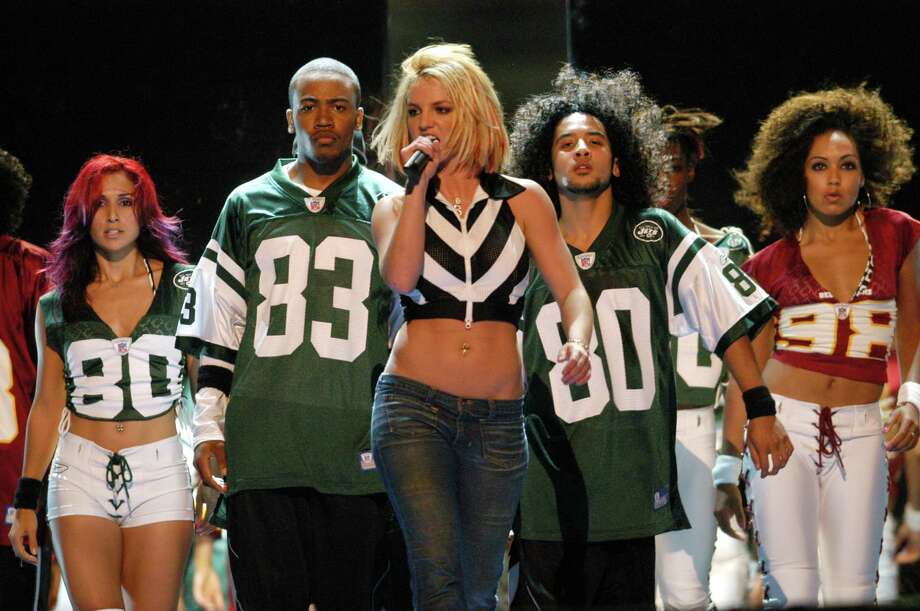 "Before Columbus Short donned the suits for ""Scandal,"" he was a back-up dancer for Britney Spears. He's pictured second from left, during a rehearsal for an NFL concert in 2003.  Photo: KMazur, Getty Images / WireImage"