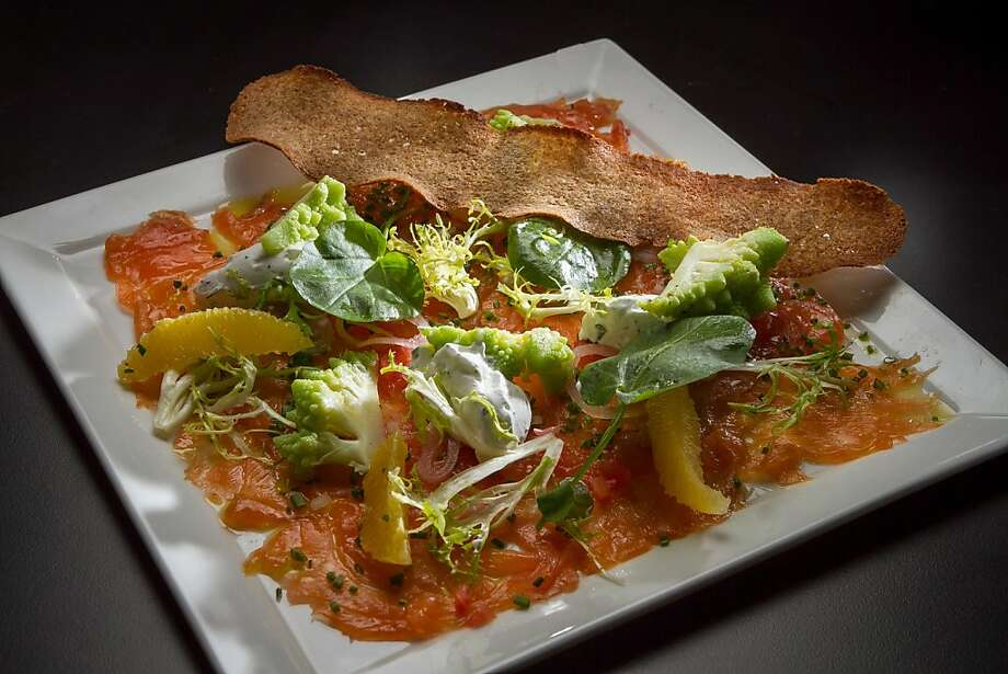 Brown sugar smoked salmon ($15), with greens, blood orange and a chicory whole wheat crisp. Photo: John Storey, Special To The Chronicle