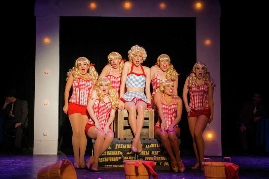 """Paige Blend (center) delivers a sharp perfor-mance as Miss Adelaide in the Playhouse's staging of """"Guys and Dolls."""" Photo: Courtesy Siggi Ragnar"""
