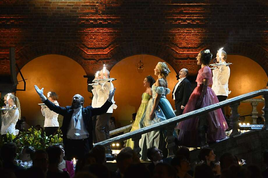 Waiters enter with the dessert at the traditional Nobel gala banquet at the Stockholm City Hall, Tuesday, Dec. 10, 2013. Photo: Henrik Montgomery, Associated Press