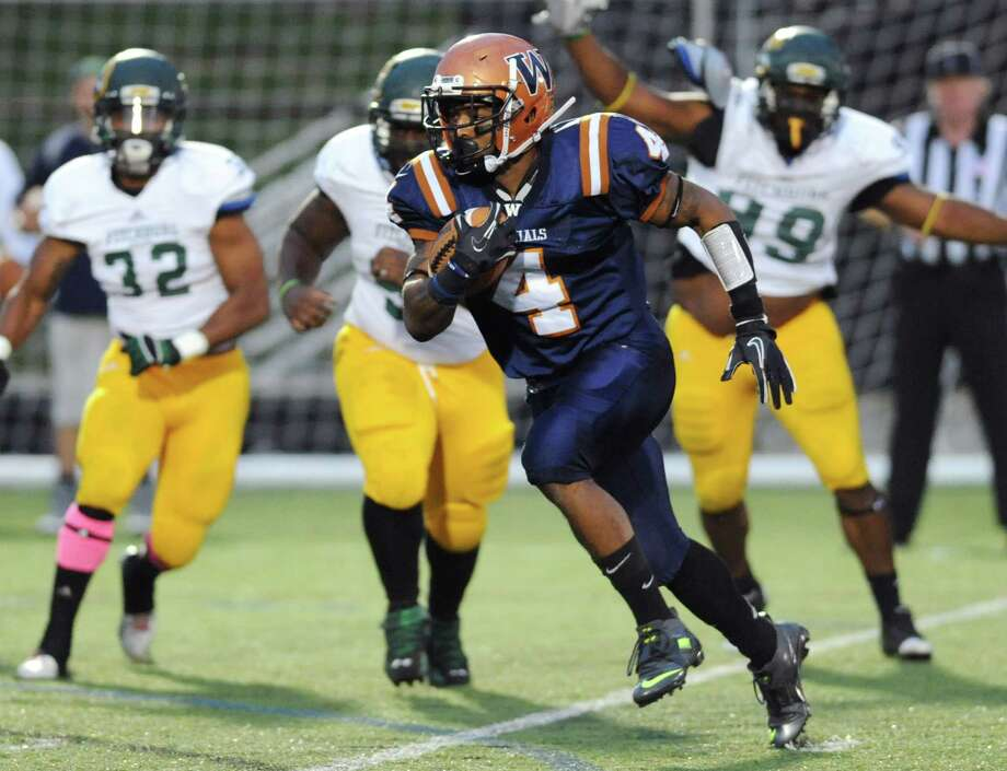 Western Connecticut running back Octavious McCoy (4) breaks away for a run in the homecoming football game between Western Connecticut State and Fitchburg State at the Westside Athletic Complex in Danbury, Conn. on Saturday, Oct. 19, 2013. Photo: Tyler Sizemore / The News-Times