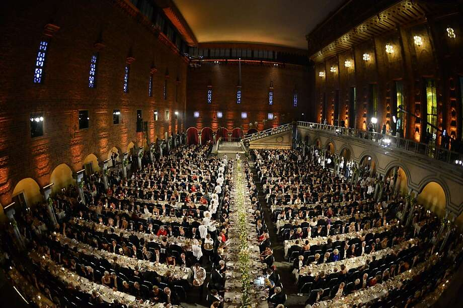 Guests attend the traditional Nobel Prize banquet at the Stockholm City Hall on December 10, 2013 following the Nobel Prize award ceremonies for Medicine, Physics, Chemistry, Literature and Economic Sciences.  Photo: Jonathan Nackstrand, AFP/Getty Images