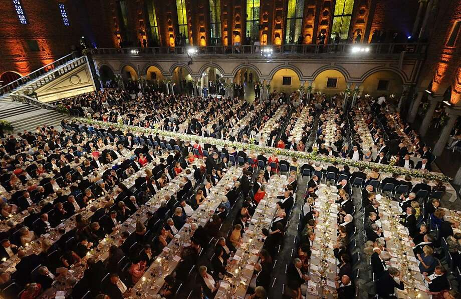 An overview of guests seated at the traditional Nobel gala banquett at the Stockholm City Hall, on December 10, 2013, following the Nobel Prize award ceremonies for Medicine, Physics, Chemistry, Literature and Economic Sciences. Photo: Henrik Montgomery, AFP/Getty Images