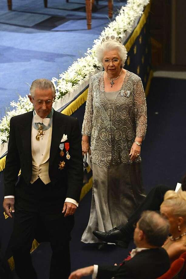 STOCKHOLM, SWEDEN - DECEMBER 10:  Princess Christina, Mrs. Magnuson (R) and Tord Magnuson (L) attend the Nobel Prize Awards Ceremony at Concert Hall on December 10, 2013 in Stockholm, Sweden. Photo: Pascal Le Segretain, Getty Images
