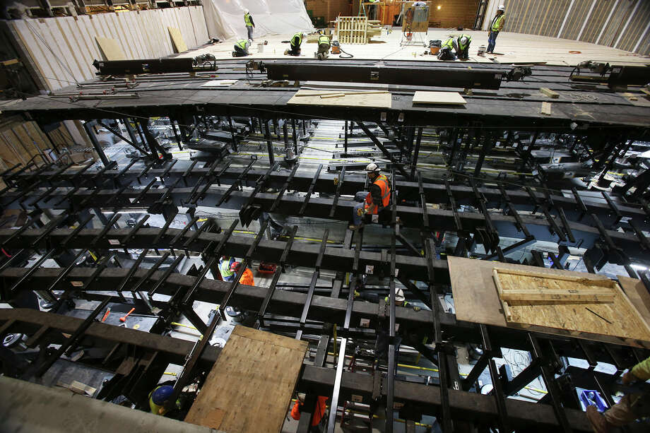 Workers install the flooring system during early construction on the Tobin Center on November 26, 2013. Photo: TOM REEL