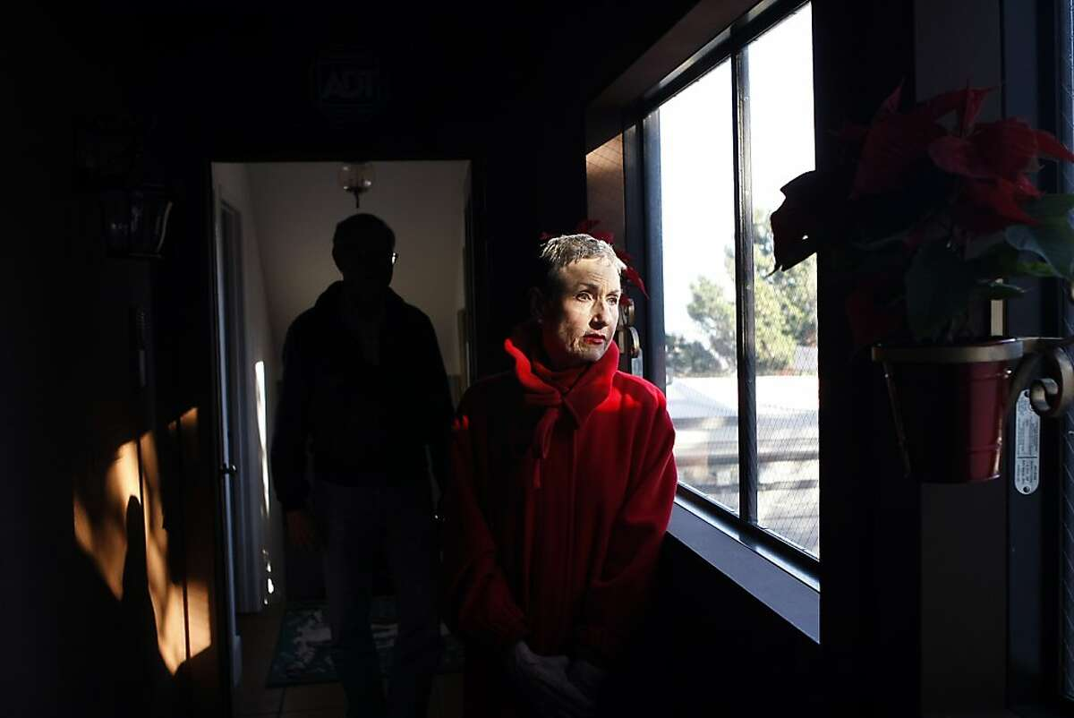 Gale Bradley and her husband Alan Hugenot pose for a portrait in their 4 unit, rent controlled apartment building which Gale has owned since 1995, in San Francisco, CA, Tuesday, December 7, 2013.