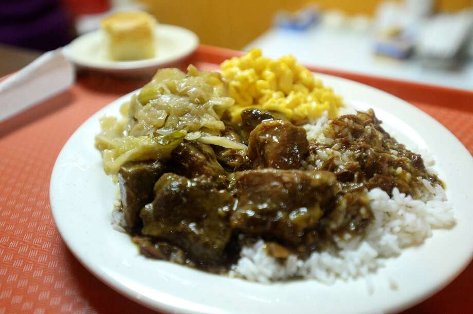 A plate of Beef Tips alongside rice and yams is offered on Tuesdays for $9.99 at Koko's . Koko's, a new sports bar and soul food restaurant is located on Washington. Michael Rivera/@michaelrivera88