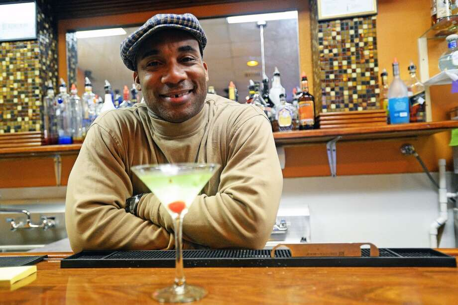Former Atlanta Falcons wide receiver Floyd Dixon Jr. at Koko's is Dec. 5 bartender of the week. He's the manager at Koko's, a new sports bar and soul food restaurant located on Washington. Michael Rivera/@michaelrivera88