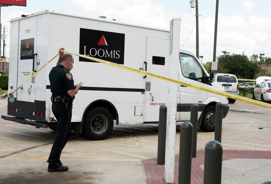 Police investigate an armored car robbery at the Walgreens off Little York and the Eastex freeway. Photo: J. Patric Schneider, Freelance / © 2013 Houston Chronicle