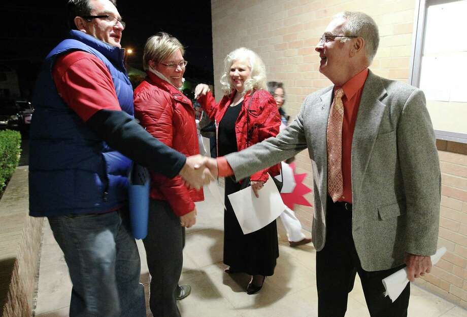 "Adams Hill Elementary Principal Donald Powers (right) and Vice Principal Karon Wernli (second from right) are greeted by supporters before the Northside ISD board meeting on Tuesday, Dec. 10, 2013. Powers and Wernli had been placed on leave from work while the district investigated ""administrative irregularities"" at the school. Both were facing potential termination proceedings. About 20 supporters for the educators came out to speak on their behalf. Photo: Kin Man Hui, San Antonio Express-News / ©2013 San Antonio Express-News"