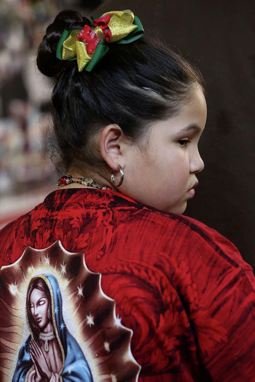 Olivia Quintero, 9, participates in Rosario a la Virgen de Guadalupe at Fuerza Unida in San Antonio on Tuesday, Dec. 10, 2013.