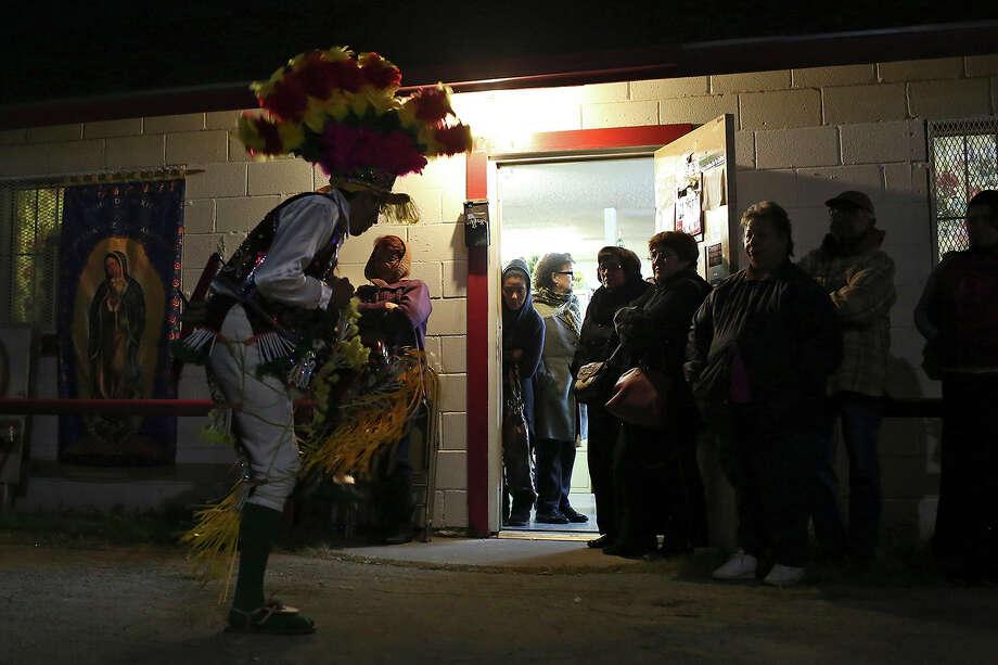 Dancers with Matlachines Chichimecas including Erasmo G. Macias, left, perform during Rosario a la Virgen de Guadalupe at Fuerza Unida in San Antonio on Tuesday, Dec. 10, 2013. Photo: Lisa Krantz, San Antonio Express-News / ©2013 San Antonio Express-News