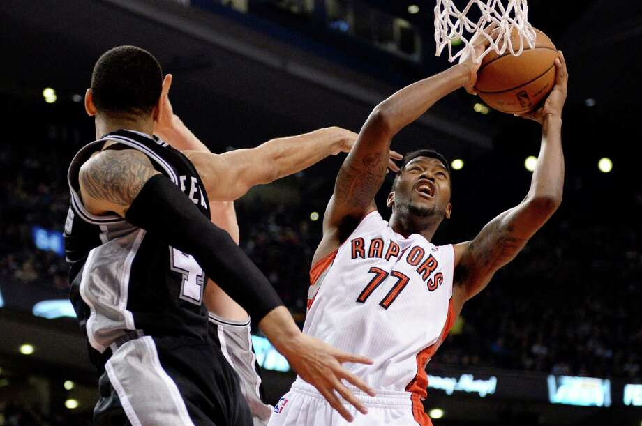 Toronto Raptors guard Julyan Stone (77) goes up for a shot as San Antonio Spurs forward Danny Green (4) defends during first half NBA basketball action in Toronto on Tuesday, Dec. 10, 2013. (AP Photo/The Canadian Press, Frank Gunn) Photo: Frank Gunn, Associated Press / CP