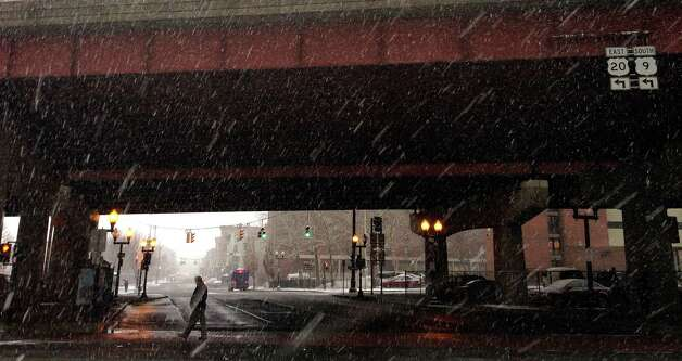 Snow falls on South Pearl St. on Tuesday, Dec. 10, 2013 in downtown Albany, NY.   (Paul Buckowski / Times Union) Photo: PAUL BUCKOWSKI / 00024968A