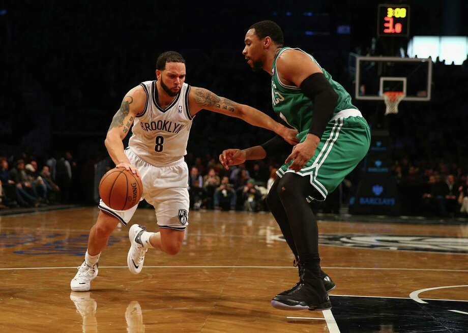 NEW YORK, NY - DECEMBER 10:  Deron Williams #8 of the Brooklyn Nets dribbles against Jared Sullinger #7 of the Boston Celtics during their game at the Barclays Center on December 10, 2013 in the Brooklyn borough of New York City. NOTE TO USER: User expressly acknowledges and agrees that, by downloading and or using this photograph, User is consenting to the terms and conditions of the Getty Images License Agreement.  (Photo by Al Bello/Getty Images) ORG XMIT: 182409025 Photo: Al Bello / 2013 Getty Images