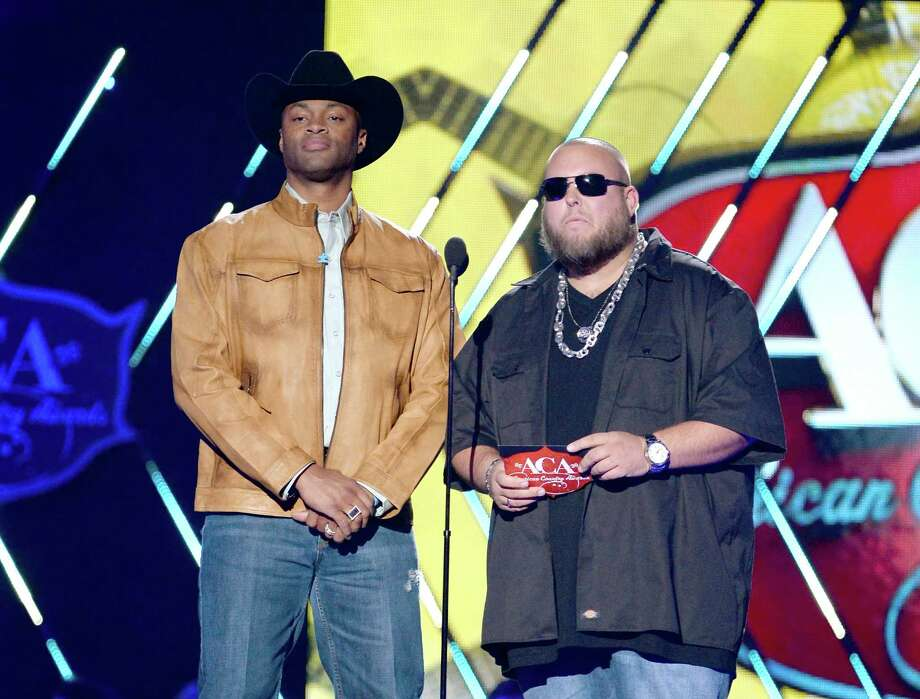 LAS VEGAS, NV - DECEMBER 10:  Presenters Cowboy Troy (L) and Big Smo speak onstage during the 2013 American Country Awards at the Mandalay Bay Events Center on December 10, 2013 in Las Vegas, Nevada. Photo: Ethan Miller, Getty Images / 2013 Getty Images