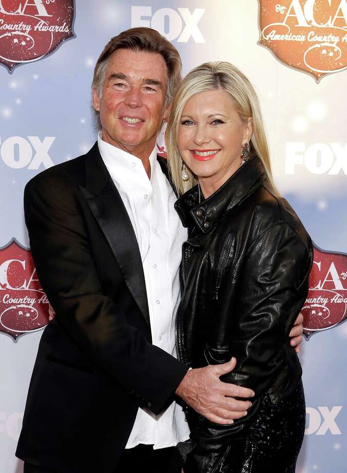 LAS VEGAS, NV - DECEMBER 10:  John Easterling and actress Olivia Newton-John arrive at the 2013 American Country Awards at the Mandalay Bay Events Center on December 10, 2013 in Las Vegas, Nevada. Photo: Isaac Brekken, Getty Images / 2013 Getty Images