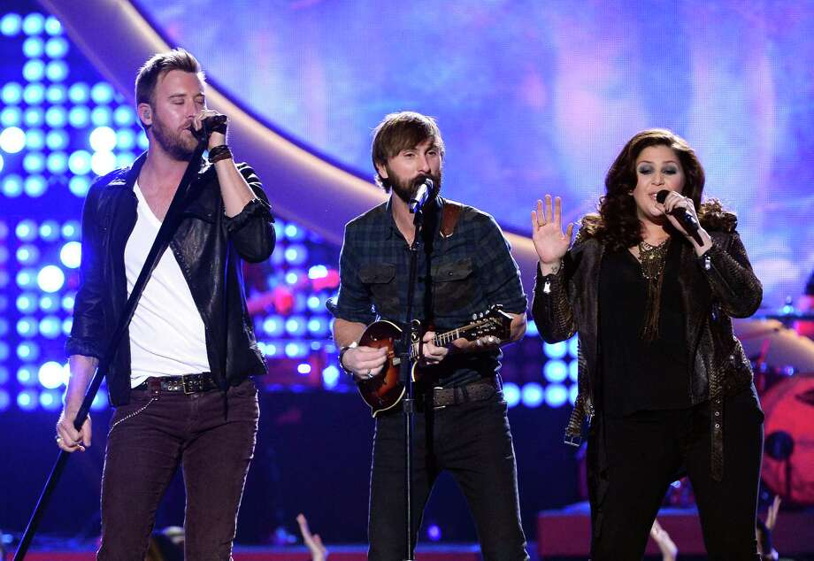 LAS VEGAS, NV - DECEMBER 10:  (L-R) Recording artists Charles Kelley, Dave Haywood and Hillary Scott of Lady Antebellum perform onstage during the 2013 American Country Awards at the Mandalay Bay Events Center on December 10, 2013 in Las Vegas, Nevada. Photo: Ethan Miller, Getty Images / 2013 Getty Images
