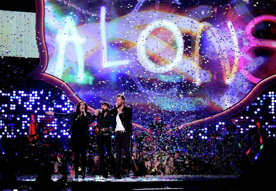 LAS VEGAS, NV - DECEMBER 10:  (L-R) Recording artists Hillary Scott, Dave Haywood and Charles Kelley of Lady Antebellum perform onstage during the 2013 American Country Awards at the Mandalay Bay Events Center on December 10, 2013 in Las Vegas, Nevada. Photo: Ethan Miller, Getty Images / 2013 Getty Images