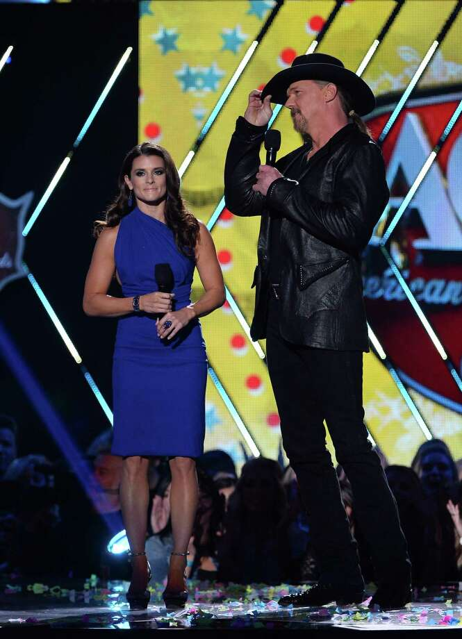 LAS VEGAS, NV - DECEMBER 10:  Co-hosts Danica Patrick and Trace Adkins speak onstage during the 2013 American Country Awards at the Mandalay Bay Events Center on December 10, 2013 in Las Vegas, Nevada. Photo: Ethan Miller, Getty Images / 2013 Getty Images