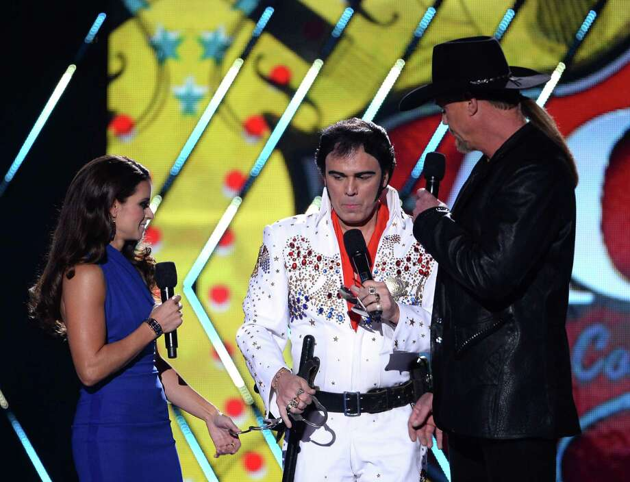 LAS VEGAS, NV - DECEMBER 10:  Co-hosts Danica Patrick (L) and Trace Adkins (R) speak onstage during the 2013 American Country Awards at the Mandalay Bay Events Center on December 10, 2013 in Las Vegas, Nevada. Photo: Ethan Miller, Getty Images / 2013 Getty Images