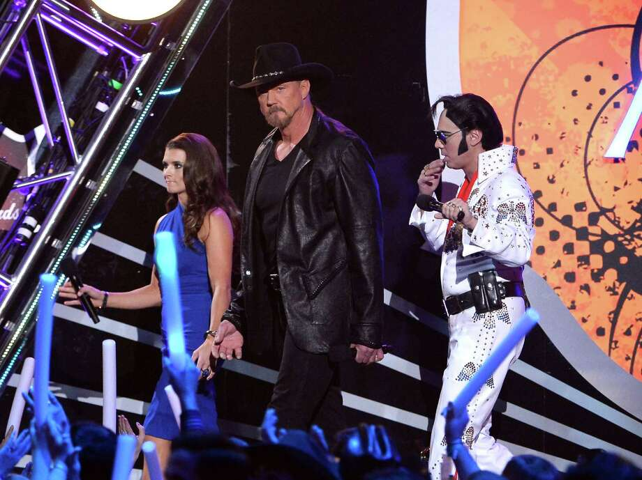 LAS VEGAS, NV - DECEMBER 10:  Co-hosts Danica Patrick (L) and Trace Adkins (C) speak onstage during the 2013 American Country Awards at the Mandalay Bay Events Center on December 10, 2013 in Las Vegas, Nevada. Photo: Ethan Miller, Getty Images / 2013 Getty Images