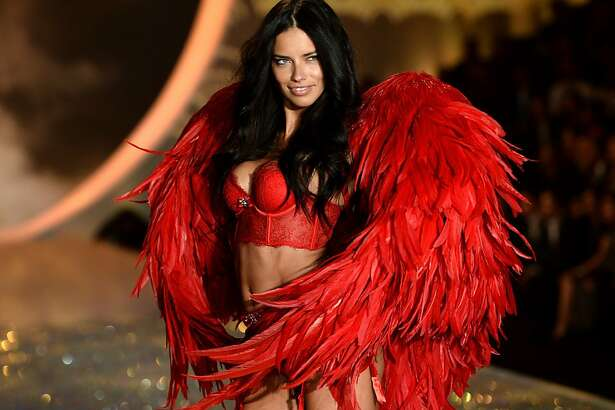 NEW YORK, NY - NOVEMBER 13:  Model Adriana Lima walks the runway at the 2013 Victoria's Secret Fashion Show at Lexington Avenue Armory on November 13, 2013 in New York City.  (Photo by Dimitrios Kambouris/Getty Images for Victoria's Secret)