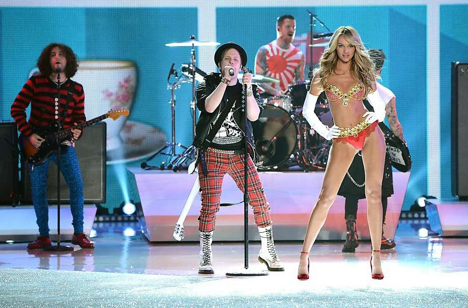 Fall Out Boy perform while model Candice Swanepoel walks the runway wearing the $10 million Royal Fantasy Bra during the 2013 Victoria's Secret Fashion Show at the 69th Regiment Armory on Wednesday, Nov. 13, 2013 in New York. (Photo by Evan Agostini/Invision/AP) Photo: Evan Agostini, Associated Press