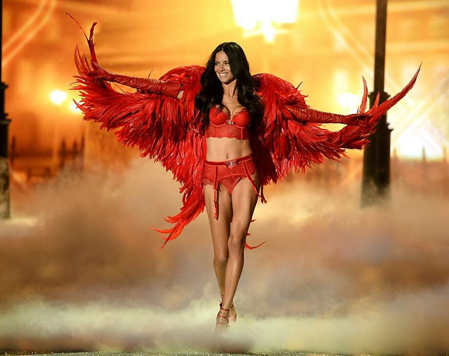 NEW YORK, NY - NOVEMBER 13:  Model Adriana Lima walks the runway at the 2013 Victoria's Secret Fashion Show at Lexington Avenue Armory on November 13, 2013 in New York City.  (Photo by Dimitrios Kambouris/Getty Images for Victoria's Secret) Photo: Dimitrios Kambouris, (Credit Too Long, See Caption)