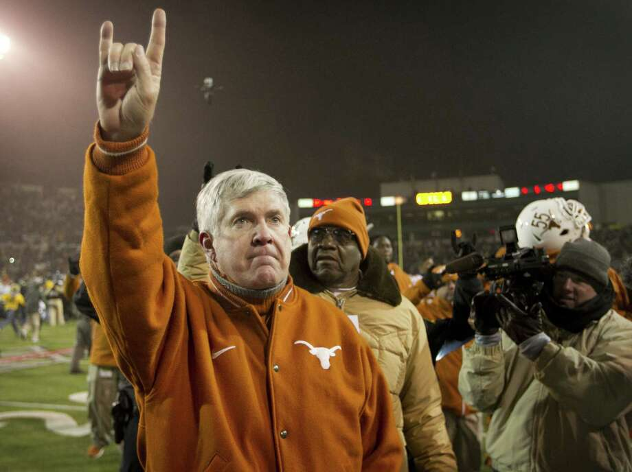 Mack Brown leaves the field after Saturday's 30-10 loss to Baylor in what likely will turn out to be his final game as Texas coach. If so, he'll depart the school with a record of 158-47 in 16 seasons, with 20 of the losses coming in the last four years. Photo: Jay Janner, MBR / Austin American-Statesman