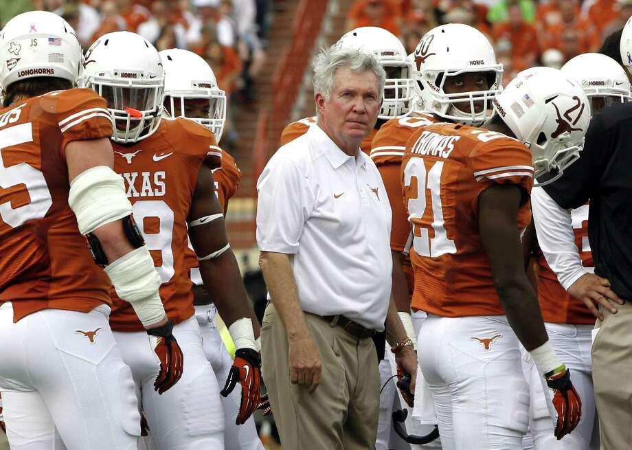 UT head coach Mack Brown, 62, is being paid $5.4 million this season as part of a contract that runs through 2020. His deal calls for a $2.75 million buyout if he's terminated this year. Photo: Associated Press / File Photo