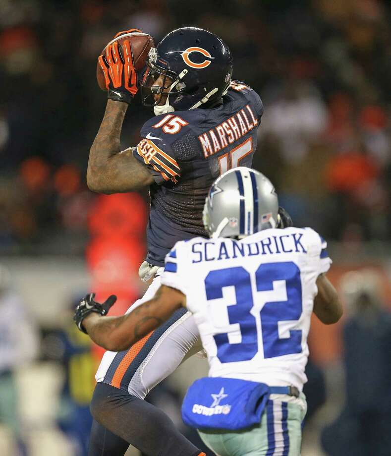 Brandon Marshall (six catches, 100 yards) and the Bears picked apart Orlando Scandrick and the Cowboys. Photo: Jonathan Daniel / Getty Images