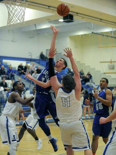 Saratoga's Sean Grecco goes in for a score during their high school boy's basketball game against Sh