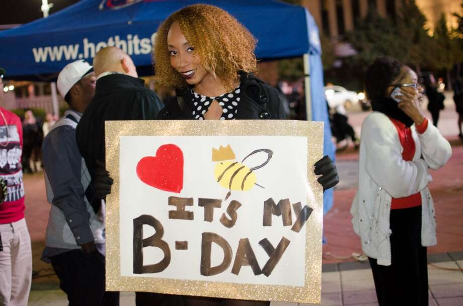 "Fan Ashley Perkins celebrates her birthday at ""The Mrs. Carter Show."" Photo: Jamaal Ellis, For The Chronicle"